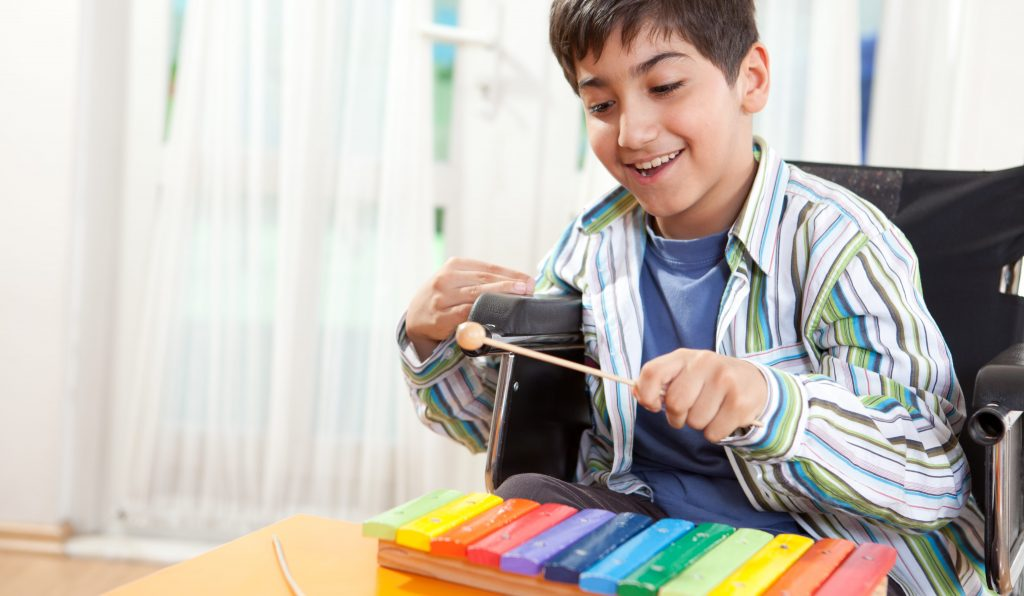 Child playing the xylophone